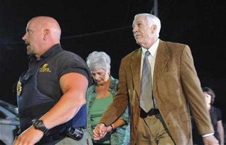 Former Penn State assistant football coach Jerry Sandusky and his wife, Dottie, arrive at the Centre County Courthouse for the jury decision on his child sex abuse trial in Bellefonte, Pennsylvania, June 22, 2012. REUTERS/Pat Little