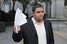 Mir Islam exits the Manhattan Federal Court in New York June 26, 2012. REUTERS/Eduardo Munoz