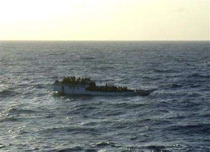 A picture released by the Australian Maritime and Safety Authority (AMSA) shows a boat which according to the AMSA was taken mid-morning before the boat sank near Christmas Island June 27, 2012. REUTERS/Australian Maritime and Safety Authority/Handout