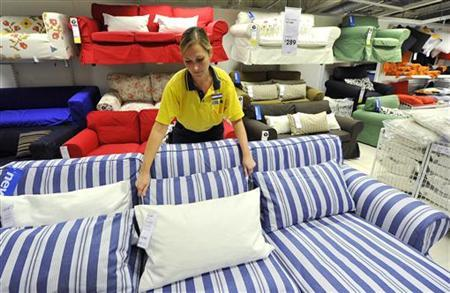 An Ikea employee works at the Wembley branch of the Swedish international furniture and home accessories company in west London October 15, 2010. REUTERS/Toby Melville/Files