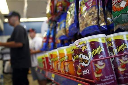 Containers of Pringles chips, a product of Procter & Gamble, are displayed at a gas station in Phoenix, Arizona October 27, 2011. REUTERS/Joshua Lott