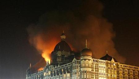Smoke rises from the Taj Hotel in Mumbai in this November 27, 2008 file photo. India said on Wednesday that a man arrested on suspicion of helping plot the 2008 Mumbai attacks had ''confirmed'' during interrogation that Pakistan was involved. REUTERS/Arko Datta/Files