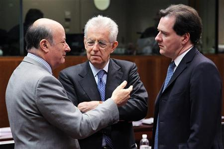 Poland's Finance Minister Jacek Rostowski (L) talks to Italy's Prime Minister and Finance Minister Mario Monti and Britain's Chancellor of the Exchequer George Osborne (R) during an European Union finance ministers meeting at the EU Council in Brussels May 15, 2012. REUTERS/Francois Lenoir