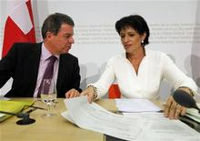 Rudolf Dieterle (L), Director of the Federal Roads Authority (ASTRA), talks to Swiss Minister of Environment, Transport, Energy and Communications Doris Leuthard during a news conference after the weekly meeting of the Federal Council in Bern June 27, 2012. The Federal Council decided to build a second road tunnel through the Gotthard, Switzerland's main north-south connection through the Alps today. REUTERS/Ruben Sprich