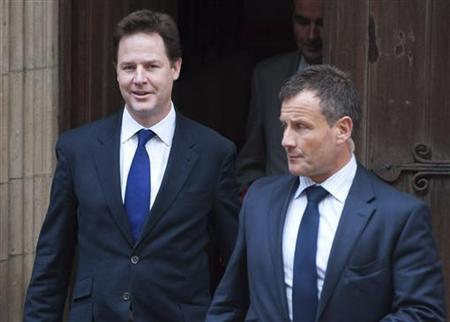 Britain's Deputy Prime Minister and leader of the Liberal Democrats Nick Clegg (L) leaves Royal Courts of Justice after giving evidence at the Leveson Inquiry in central London, June13, 2012. REUTERS/ Ki Price