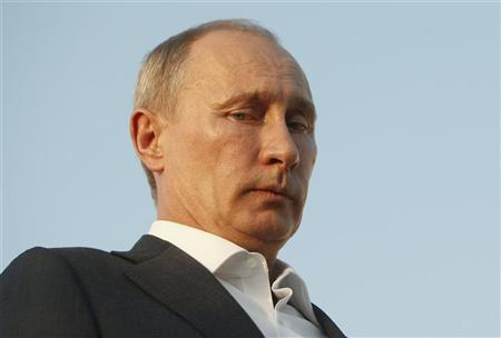 Russia's President Vladimir Putin attends the opening ceremony of the Russian Pilgrims' House at the Jordanian side of the Jordan River, June 26, 2012. REUTERS/Ali Jarekji