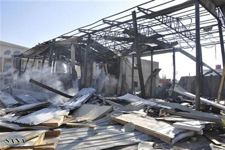 Damaged buildings are seen after gunmen stormed the headquarters of Al-Ikhbariya news channel near Damascus June 27, 2012 in this handout photograph released by Syria's national news agency SANA. REUTERS/SANA