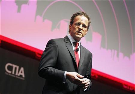 Philipp Humm, CEO & President of T-Mobile USA addresses attendees during the International CTIA WIRELESS Conference & Exposition in New Orleans, Louisiana May 8, 2012. REUTERS/Sean Gardner