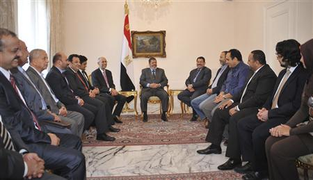The Muslim Brotherhood's President-elect Mohamed Mursi (C) meets with Egyptian political leaders and activists at the presidential palace in Cairo June 27, 2012. REUTERS/Egyptian Presidency/Handout