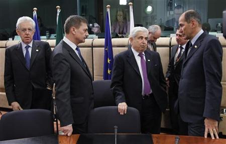 (L-R) Italy's Prime Minister Mario Monti, Estonia's Prime Minister Andrus Ansip, Cyprus' President Demetris Christofias and Slovenia's Prime Minister Janez Jansa attend a European Union leaders summit in Brussels March 2, 2012 . REUTERS/Francois Lenoir