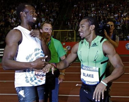 Usain Bolt of Jamaica (L) congratulates his compatriot Yohan Blake for his victory in the men's 200 metres event at the Memorial Van Damme, IAAF Diamond League athletics meeting in Brussels September 16, 2011. REUTERS/Francois Lenoir