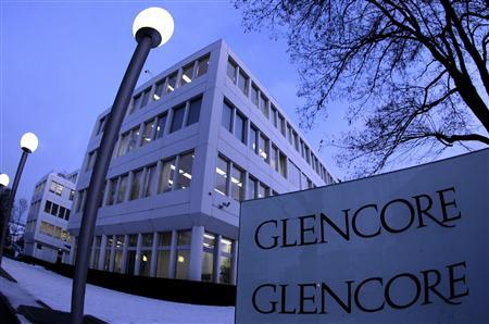 Swiss commodities trader Glencore's logo is seen in front of its headquarters in Baar, near Zurich in this February 6, 2012 file photo. Qatar, Xstrata's second largest shareholder, threw a huge roadblock in the way of Glencore's $30 billion takeover of the miner with a surprise demand on June 26, 2012 for better terms. REUTERS/Romina Amato/Files