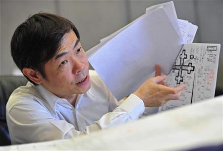 Zhang Yue, founder and CEO of Broad Group, gestures as he talks about his building designs during an interview with Reuters in his office at the company's headquarter in Changsha, Hunan province April 26, 2012. REUTERS/China Daily/Files