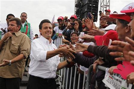 Mexican presidential front-runner Enrique Pena Nieto (2nd L) greets supporters at one of his last campaign rallies in Toluca June 27, 2012. REUTERS/Tomas Bravo