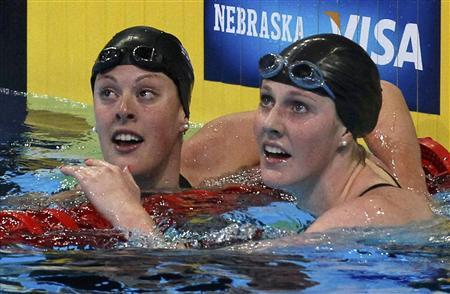 Allison Schmitt (L) and Missy Franklin check their times after their women's 200m freestyle semifinal during the U.S. Olympic swimming trials in Omaha, Nebraska, June 27, 2012. REUTERS/Jeff Haynes