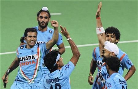 File photo of Indian hockey players celebrating after they won their London 2012 Olympic Games men's field hockey qualifying match against Canada in New Delhi February 22, 2012. REUTERS/B Mathur/Files