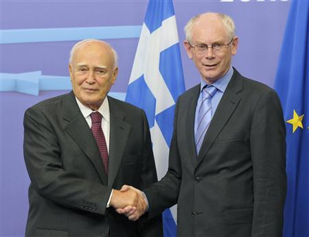 European Council President Herman Van Rompuy poses with Greek's President Karolos Papoulias (L) before their meeting at the EU Council in Brussels June 27, 2012. REUTERS/Laurent Dubrule