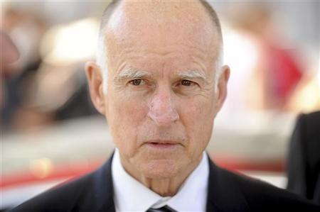 California Governor Jerry Brown attends a celebration at Tesla's factory in Fremont, California, June 22, 2012, as the car company began delivering its Model S electric sedan. REUTERS/Noah Berger