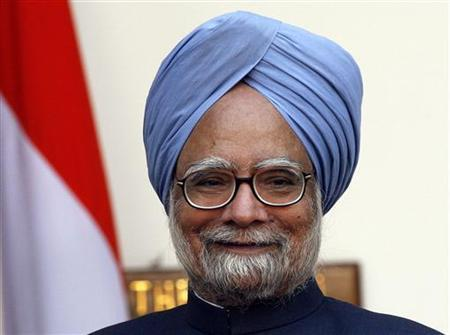 Prime Minister Manmohan Singh smiles before his meeting with China's President Hu Jintao in New Delhi November 21, 2006. REUTERS/B Mathur/Files