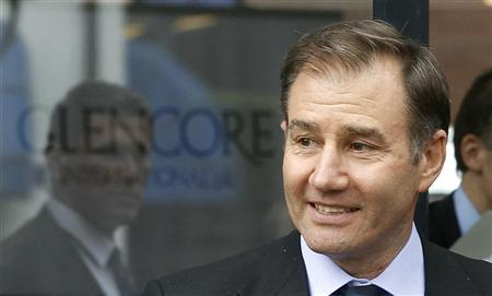 Glencore CEO Ivan Glasenberg smiles as he leaves after the company's annual shareholder meeting in the Swiss town of Zug May 9, 2012. REUTERS/Arnd Wiegmann