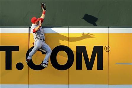 Los Angeles Angels center fielder Mike Trout catches a Baltimore Orioles batter J.J. Hardy (not pictured) home run in the first inning during their MLB American League baseball game in Baltimore, Maryland, June 27, 2012. REUTERS/Patrick Smith