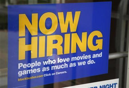 A help wanted sign hangs on the door of a Blockbuster movie and game store in Golden, Colorado September 17, 2009. REUTERS/Rick Wilking