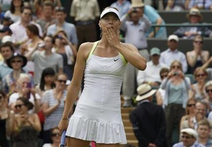 Maria Sharapova of Russia celebrates after defeating Tsvetana Pironkova of Bulgaria in their women's singles tennis match at the Wimbledon tennis championships in London June 28, 2012. REUTERS/Stefan Wermuth