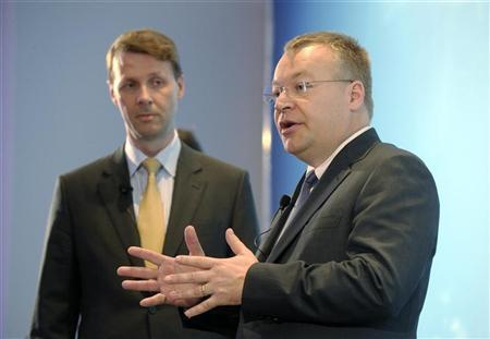 Nokia President and Chief Executive Stephen Elop (R) and incoming chairman Risto Siilasmaa address reporters during a news conference ahead of the company's annual shareholders meeting in Helsinki May 3, 2012. REUTERS/Markku Ulander/Lehtikuva
