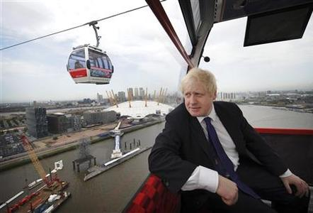 London Mayor Boris Johnson rides the Airline cable car that links North Greenwich Penninsula and the Albert Docks in east London on June 27, 2012. REUTERS/Pool/Stefan Rousseau