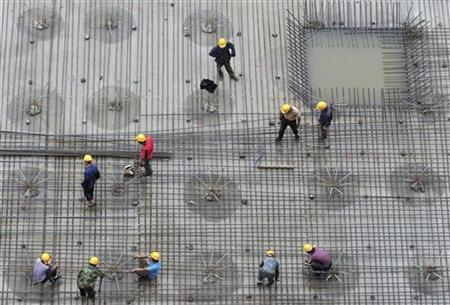 Labourers install steel bars on the foundation of a residential construction site in Shenyang, Liaoning province June 29, 2010. REUTERS/Sheng Li