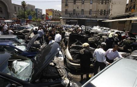 Wrecked cars are seen at the site of an explosion outside Syria's highest court in central Damascus June 28, 2012. REUTERS-Khaled alHariri