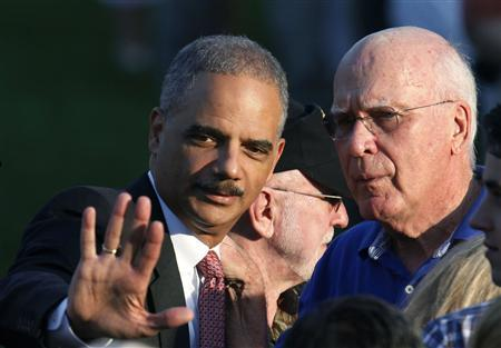 U.S. Attorney General Eric Holder (L) and Chairman of the Senate Judiciary Committee Sen. Patrick Leahy talk on the South Lawn of the White House during a picnic for Members of Congress, hosted by U.S. President Barack Obama, in Washington June 27, 2012. REUTERS/Larry Downing