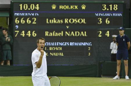 Lukas Rosol of the Czech Republic celebrates after defeating Rafael Nadal of Spain in their men's singles tennis match at the Wimbledon tennis championships in London June 28, 2012. REUTERS/Stefan Wermuth