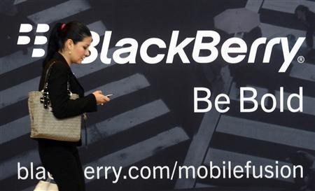 A woman uses her mobile phone at the Blackberry World Event in Orlando in this May 1, 2012 file photo. REUTERS/David Manning/Files