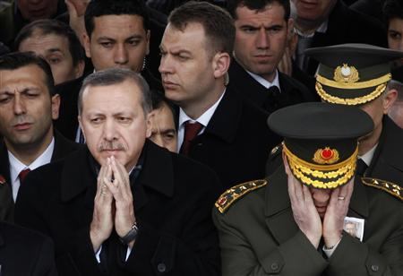 Turkey's Prime Minister Tayyip Erdogan (L) and Chief of Staff General Ilker Basbug pray during a funeral in Ankara in this February 28, 2010 file photo. REUTERS/Umit Bektas/Files