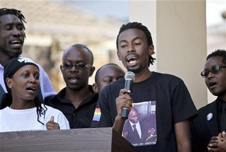 Members of Uganda's gay community lead a choir during a memorial service for David Kato on his first death anniversary in Kampala January 26, 2012. Kato, one of the country's most visible gay campaigners, was beaten to death with a hammer at his home on January 26, 2011 and died on the way to hospital. REUTERS/Edward Echwalu