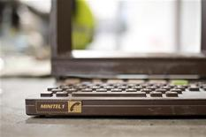 The plastic shell and keyboard of a French Minitel terminal is broken down for recycling in Portet-Sur-Garonne, southwestern France May 23, 2012. REUTERS/Bruno Martin