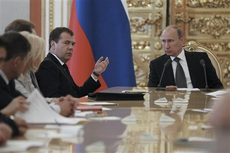 Russian President Vladimir Putin (R) and Prime Minister Dmitry Medvedev (2nd R) take part in a budget meeting with senior government officials in Moscow's Kremlin June 28, 2012. REUTERS/Dmitry Astakhov/RIA Novosti/Pool