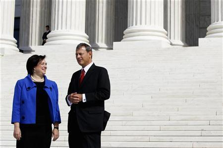 Justice Elena Kagan talks to Chief Justice of the United States John Roberts outside the Supreme Court following her formal investiture ceremony in Washington October 1, 2010. REUTERS/Larry Downing