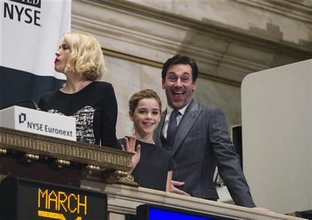 Actors from the show ''Mad Men'' Jon Hamm (R) and Kiernan Shipka react with January Jones (L) while visiting the New York Stock Exchange to ring the opening bell in New York, March 21, 2012. REUTERS/Lucas Jackson