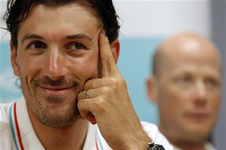 RadioShack-Nissan rider Fabian Cancellara of Switzerland (L) attends a news conference ahead of the 99th Tour de France cycling race in Liege, June 28, 2012. REUTERS/Stephane Mahe