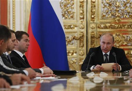 Russian President Vladimir Putin (R) speaks as Prime Minister Dmitry Medvedev (2nd L) looks on during a budget meeting with senior government officials in Moscow's Kremlin June 28, 2012. REUTERS/Sergei Karpukhin
