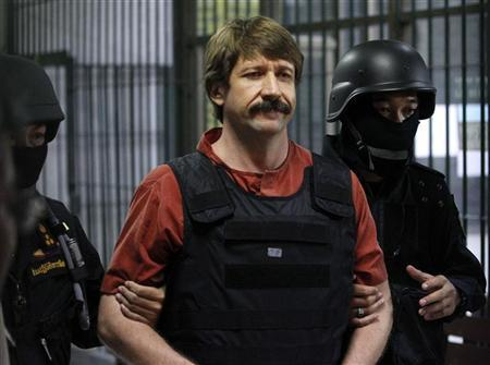 Suspected Russian arms dealer Viktor Bout is escorted by members of a special police unit after a hearing at a criminal court in Bangkok October 5, 2010. REUTERS/Sukree Sukplang