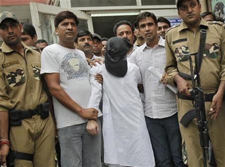Sayeed Zabiuddin Ansari, with his face covered, leaves from a hospital in New Delhi June 29, 2012. REUTERS/Adnan Abidi