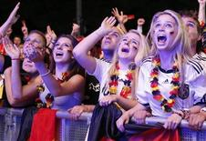 German soccer fans react during a public screening, while they watch their team play against Italy in their Euro 2012 semi-final soccer match, in Berlin June 28, 2012. REUTERS/Fabrizio Bensch