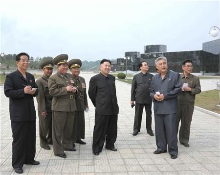 North Korean leader Kim Jong-Un (C) visits the construction of Changjon Street nearing its completion in this undated picture released by the North's official KCNA news agency in Pyongyang May 26, 2012. REUTERS/KCNA
