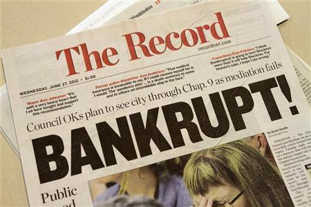 A local newspaper headline announces bankruptcy in Stockton, California June 27, 2012. REUTERS/Kevin Bartram