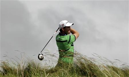 Padraig Harrington of Ireland drives off the 14th tee on the second day of the Irish Open at Royal Portrush, Northern Ireland June 29, 2012. REUTERS/Cathal McNaughton