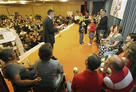 Mayor of Figueres Santi Vila (L) speaks during a marriage ceremony for multiple groups of partners at the Second European Meeting of Lesbian, Gay, Bisexual and Transgender (LGBT) people in Lloret de Mar, near Girona May 1, 2012. REUTERS/Joan Castro/Files