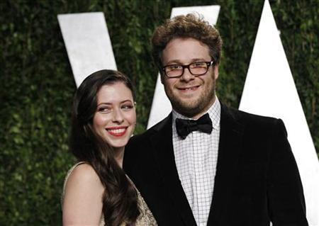 Actor Seth Rogen and his wife Lauren Miller arrive at the 2012 Vanity Fair Oscar party in West Hollywood, California February 26, 2012. REUTERS/Danny Moloshok